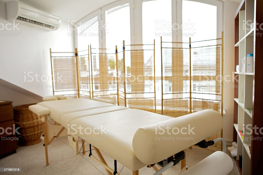 Empty massage table in room stock photo