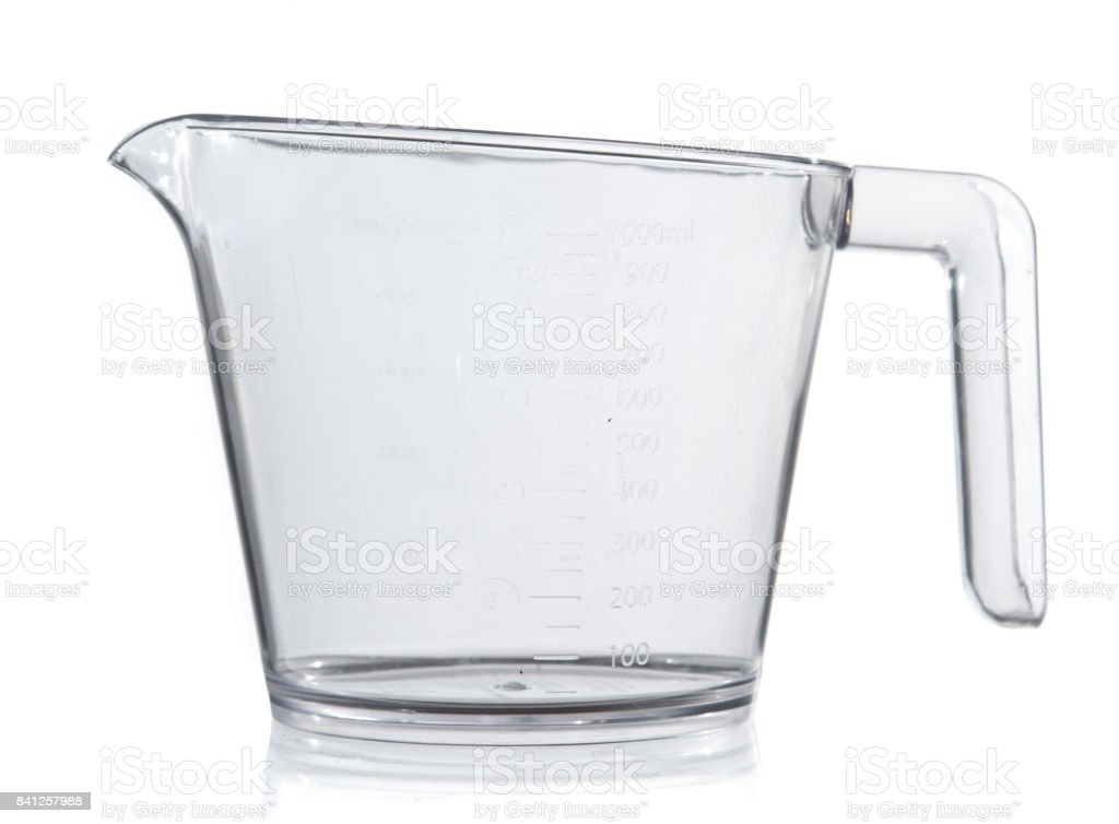Empty measuring cup on white background stock photo