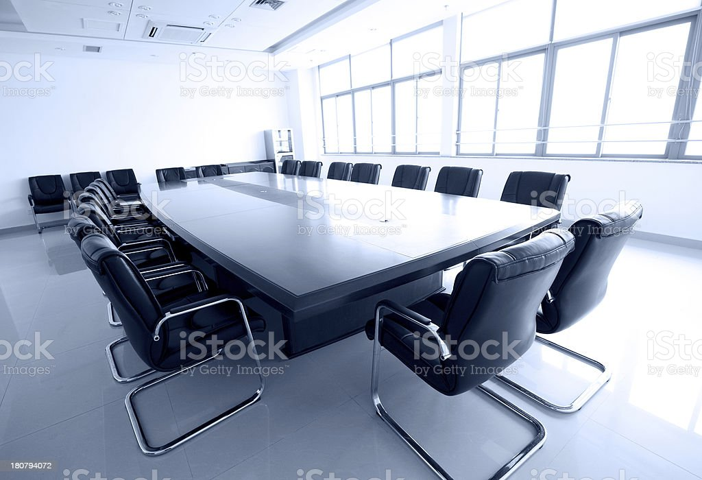 Empty meeting room in tones of white and gray royalty-free stock photo