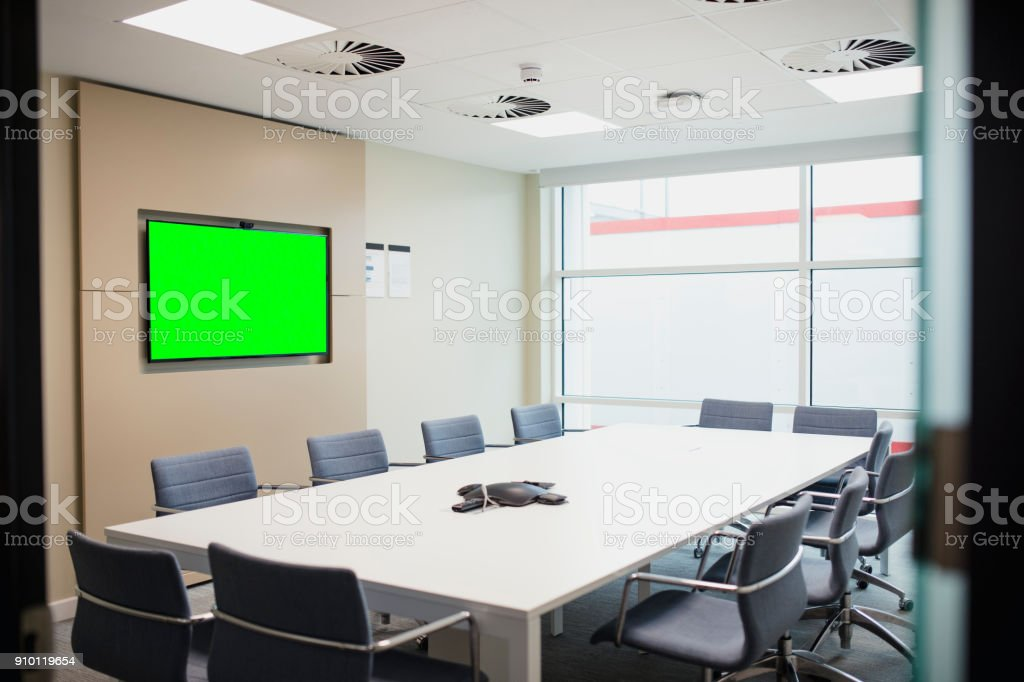 Image of an empty meeting room. There is a chroma key monitor