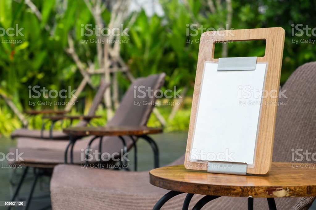 Empty Menu Frame Standing On Wood Table In Outdoor Cafe Near The - Standing cafe table
