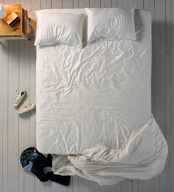 Empty Messy Bed stock photo
