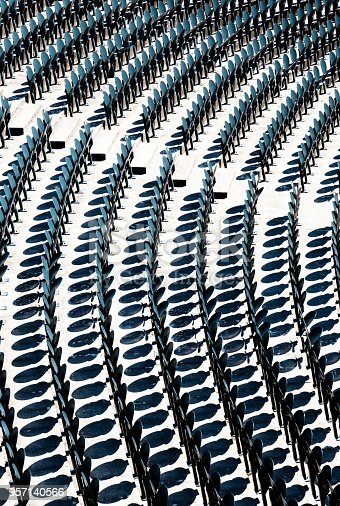 istock Empty metal chairs in the audience in the amphitheater opaque background 957140566