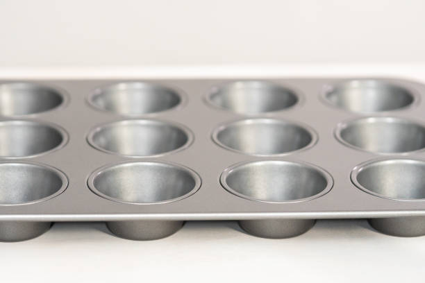 Empty metal cupcake pan on the table. Empty metal cupcake pan on the table. muffin tin stock pictures, royalty-free photos & images