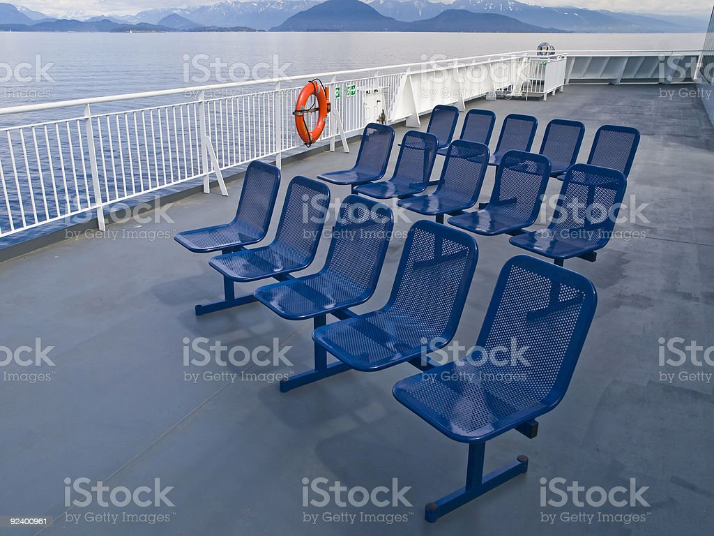 Empty metal deck chairs stock photo