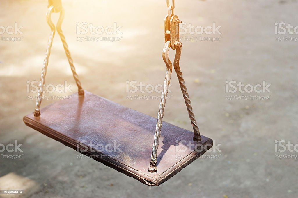 Empty metal swing in playground stock photo