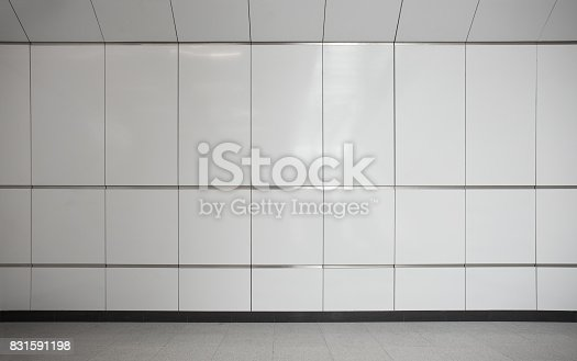 istock Empty metro station interior with tile wall and floor 831591198