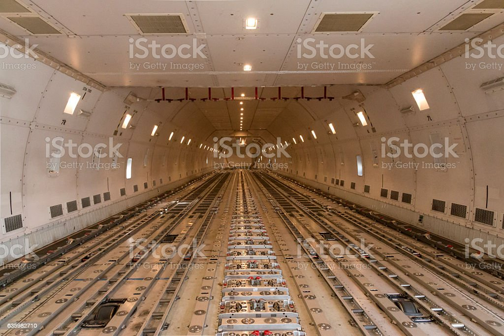 Empty modern civil airplane cargo hold stock photo