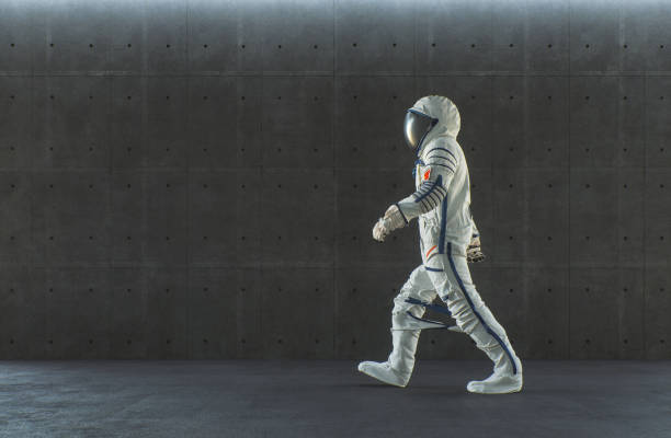 Empty modern concrete office with walking spaceman stock photo