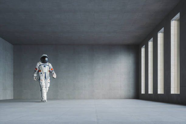 empty modern concrete office with walking spaceman - astronaut stock pictures, royalty-free photos & images