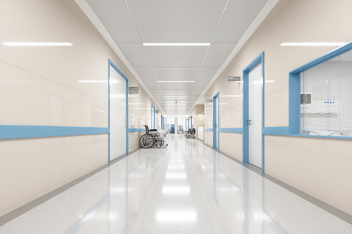 Corridor of an empty modern Japanese hospital with Japanese and English signages.