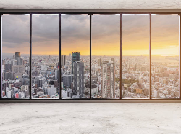 Empty modern interior space with skyscraper city view in sunset, Empty Business Office Interior stock photo