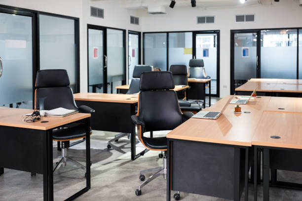 Empty modern office with desk, chair, laptop temporarily closed from government measures protective during pandemic of virus stock photo