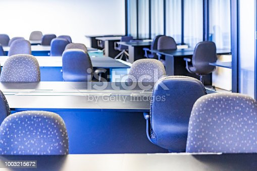 Empty modern open plan office for telecommuter to share by hot desking