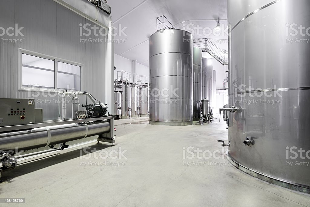 Empty modern wine cellar and stainless steel tanks stock photo