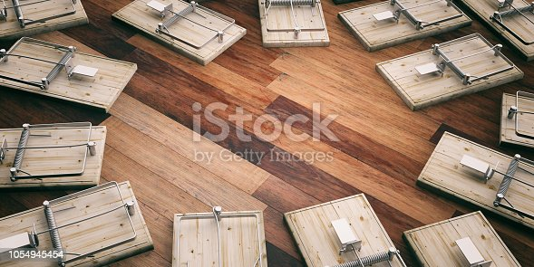 Empty mouse traps on wooden floor, space for text. 3d illustration