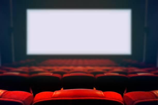 Empty movie cinema with blank white screen stock photo