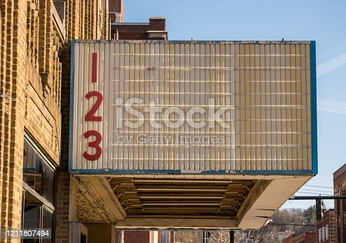 Blank movie cinema billboard or marquee sign in typical USA High street in downtown city