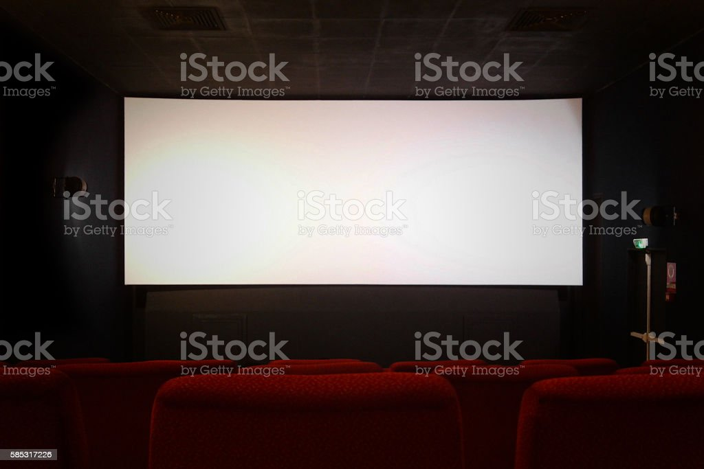 Empty movie theater with blank screen stock photo