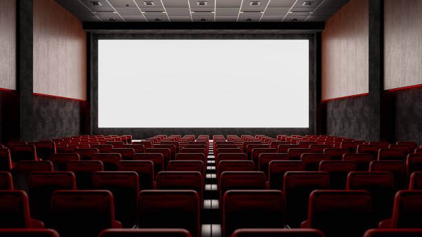 Empty Movie Theater with Red Seats and Blank Screen stock photo