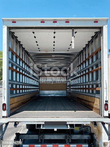 Empty moving van with rear doors opened