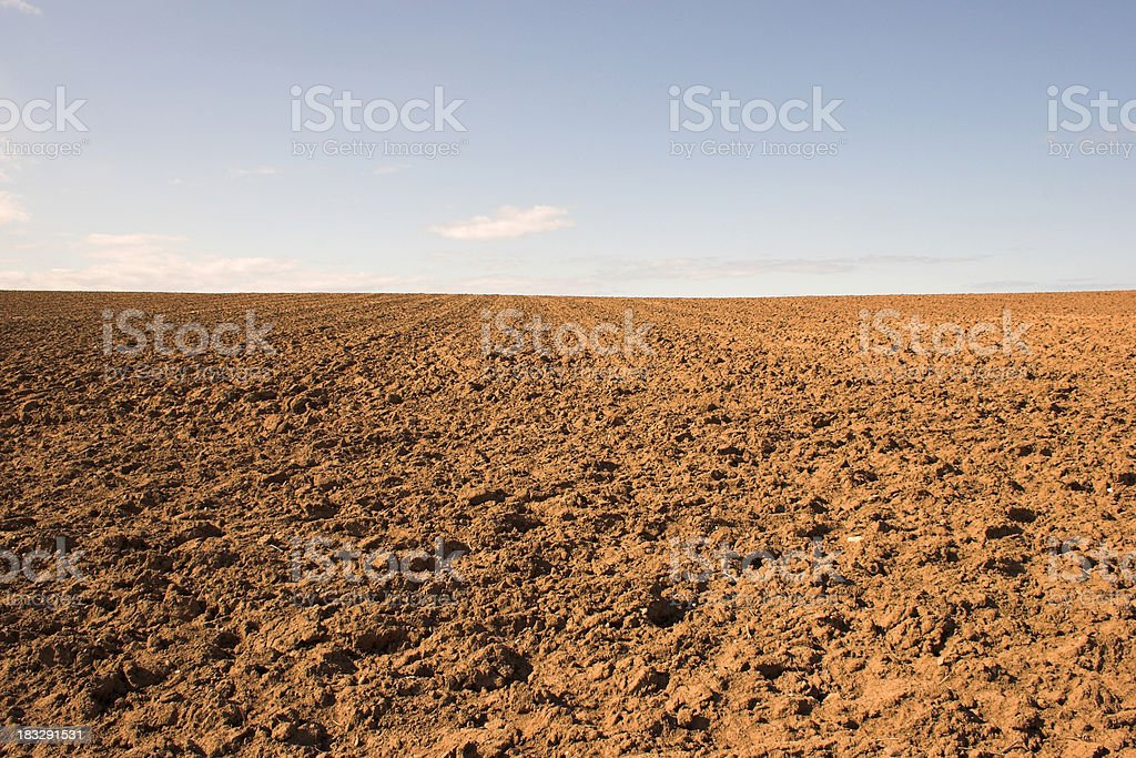 Empty muddy field of red soil stock photo