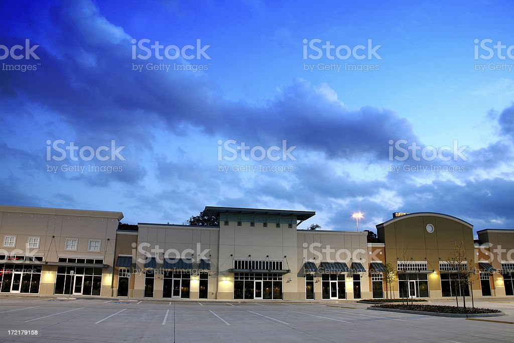 Empty new strip mall, shopping center buildings. Dusk, parking lot. stock photo