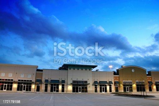 Empty New Strip Mall Shopping Center Buildings Dusk
