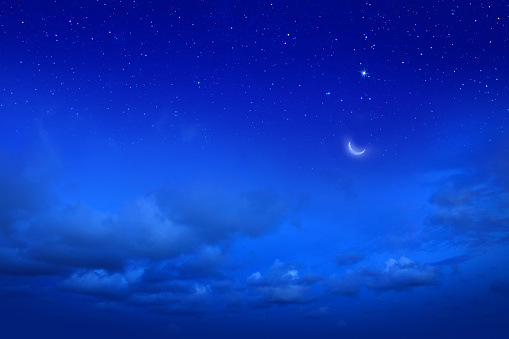 cloudscape image of blue night sky and stars