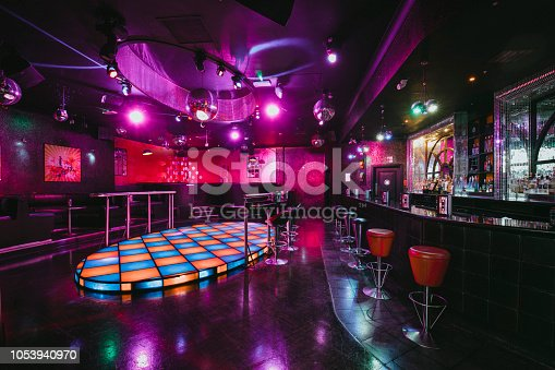 An empty shot of a room with a dance floor in the nightclub.