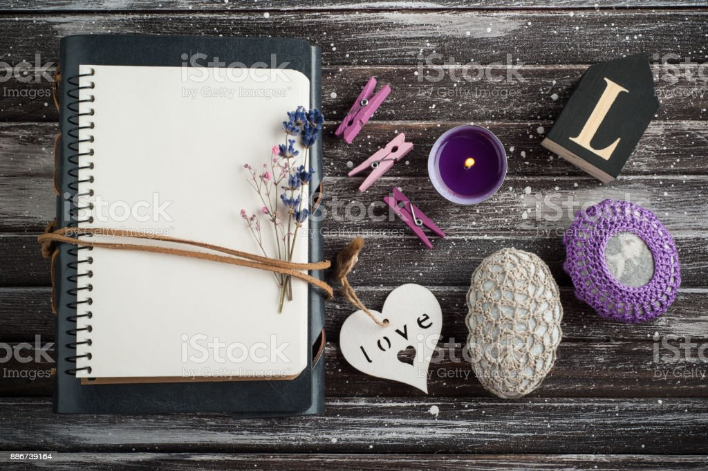 Empty notebook, crochet pebble paperweight stock photo