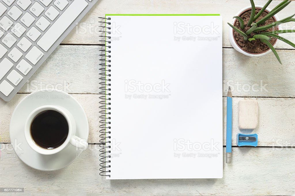 Empty notebook on a white wooden table at coffee time. stock photo