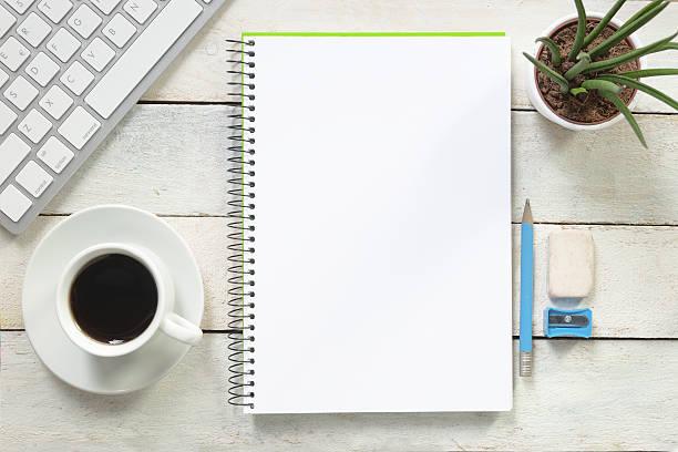 empty notebook on a white wooden table at coffee time. - kreide farbe schreibtisch stock-fotos und bilder