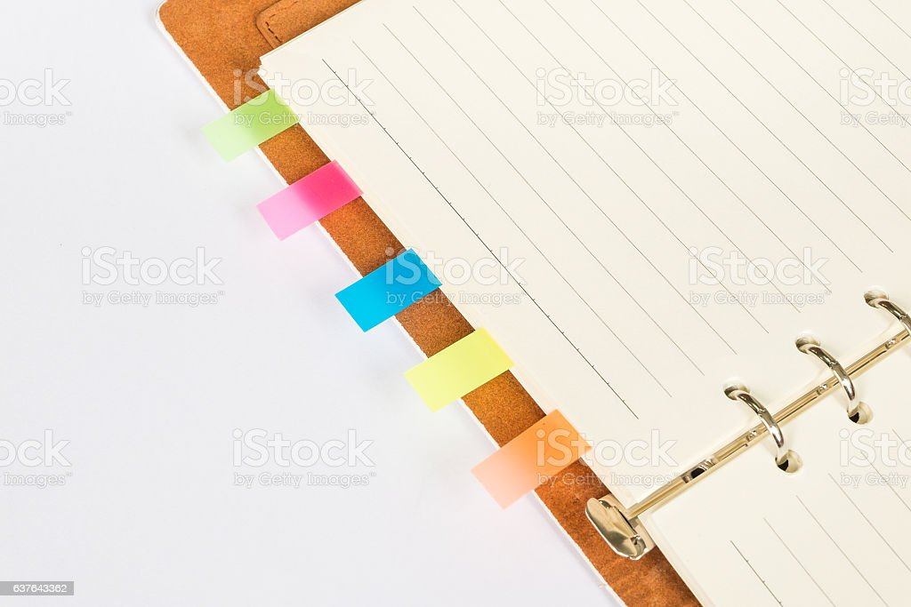 empty notebook (memo) open with colour tabs for bookmarks stock photo