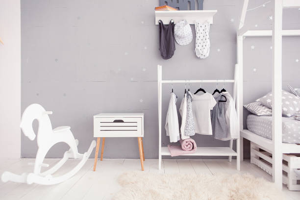 Empty nursery room with clear wall, toys and wooden horse stock photo