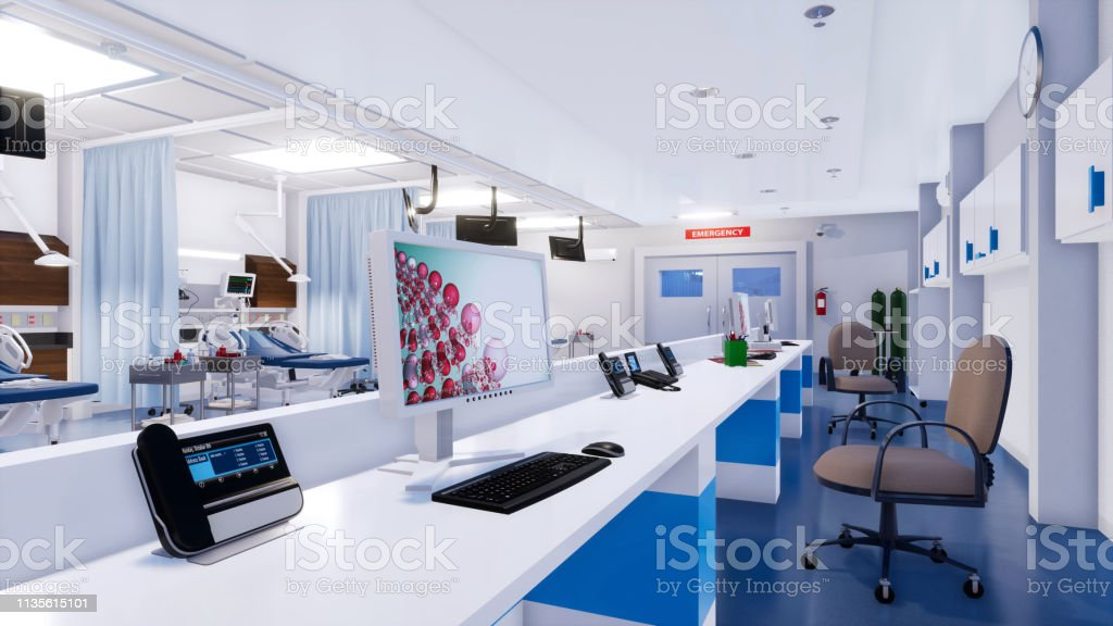 Close-up of empty nurses station with computer screen and...