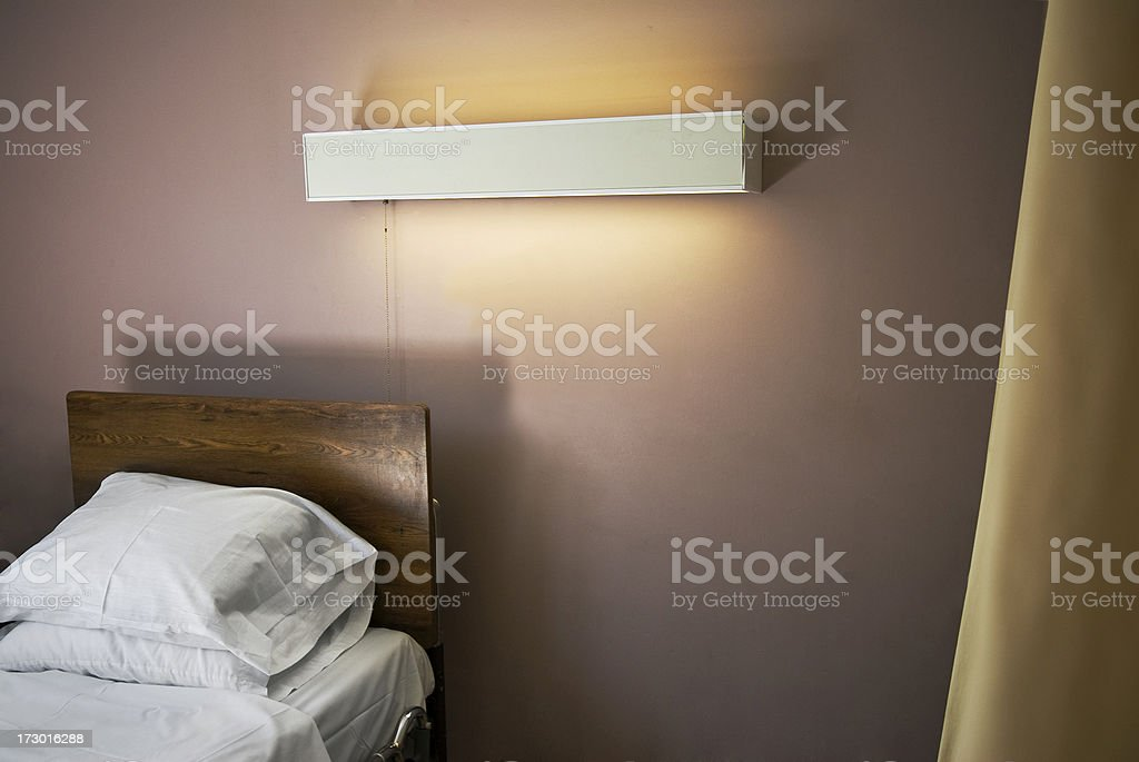 Empty Nursing Home Bed royalty-free stock photo