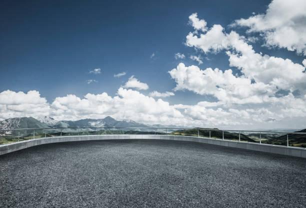 empty observation platform front of mountain range stock photo