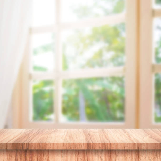 Empty of wooden table top on curtain and window background with blur of nature environment morning concept. Wood table and space for place your product or design. stock photo