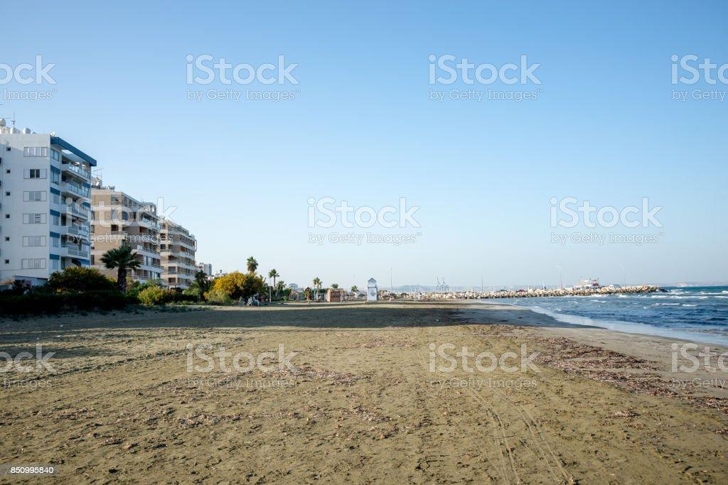 Empty off season Kastela beach in Larnaca with MacKenzie Marina in background, Cyprus stock photo