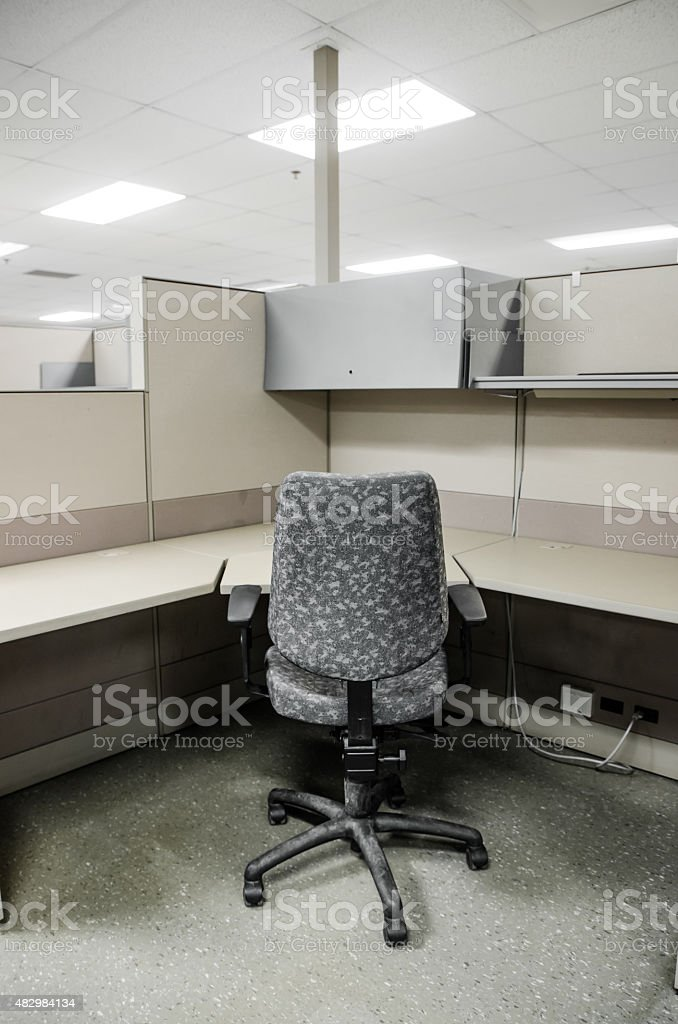 Empty office cubicle with chair