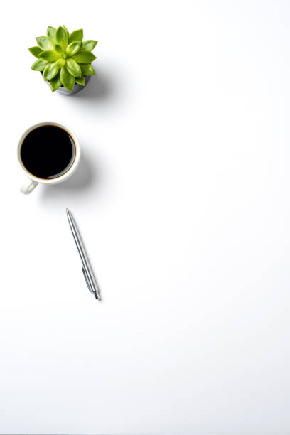 Empty office desktop with coffee and pen stock photo