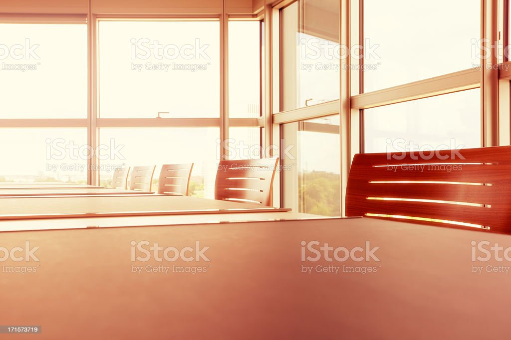 Empty Office Interior Flooded With Sunlight stock photo