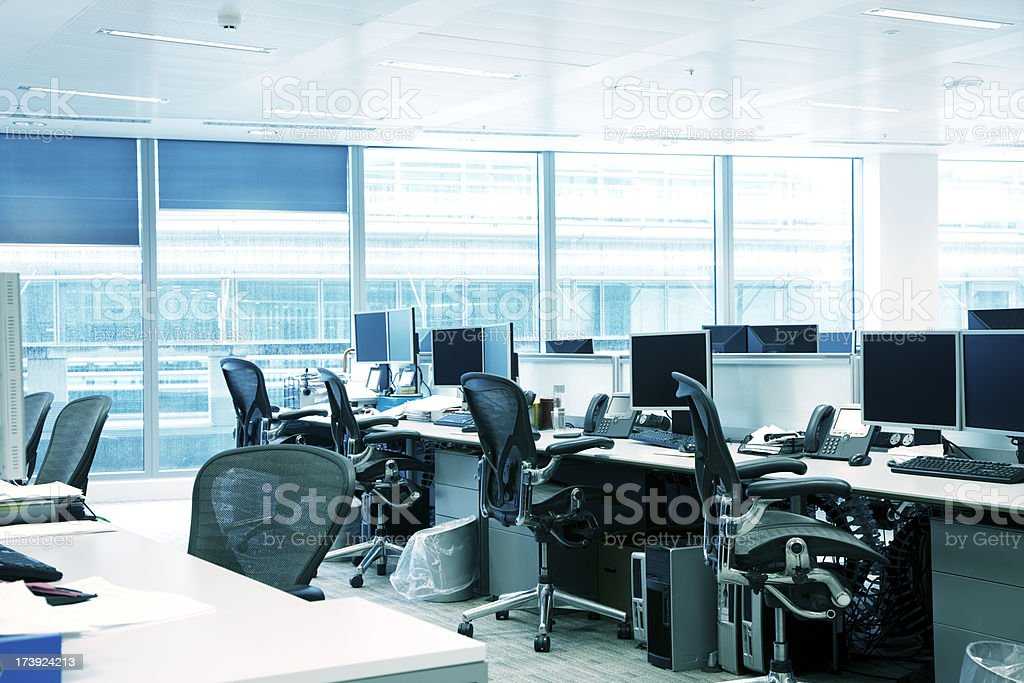 Empty Office Interior With Chairs, Computers, Desktops And Blue Windows stock photo