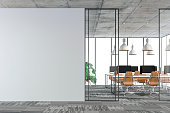 istock Empty office interior with copy space and wordesks on carpet floor 1254949064