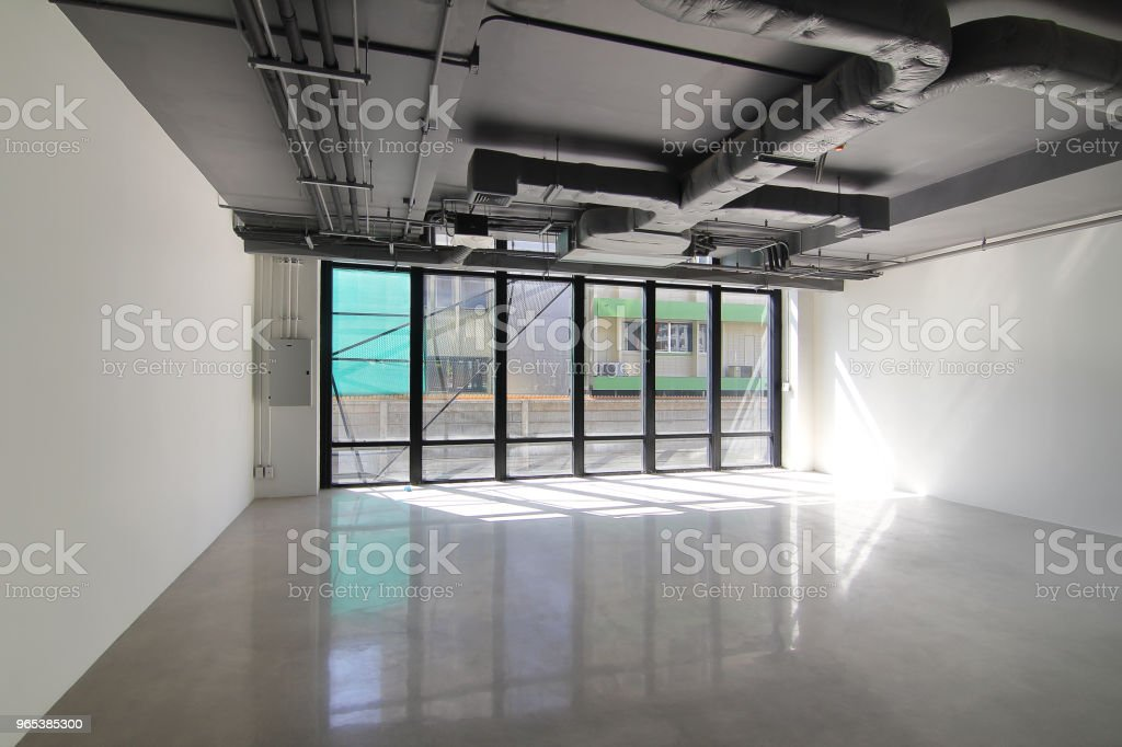 Empty office room on modern building with sunlight and indoor ventilation system on hight ceiling of large building royalty-free stock photo