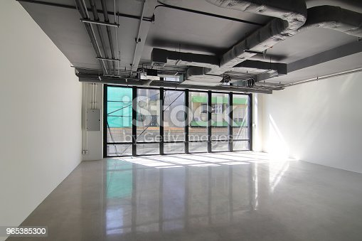 Empty Office Room On Modern Building With Sunlight And Indoor Ventilation System On Hight Ceiling Of Large Building Stock Photo & More Pictures of Air Conditioner