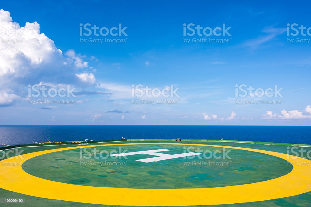 Empty oil rig helipad with few cloud and blue sky stock photo