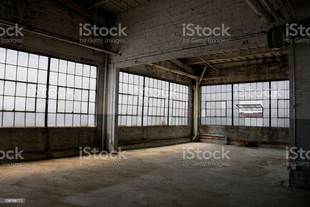 Empty, old, abandoned factory warehouse stock photo