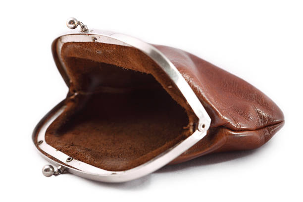 Empty old Change Purse Closeup of an empty old brown purse. It shows it is emty. empty wallet stock pictures, royalty-free photos & images
